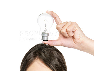 Buy stock photo Idea - Cropped image of a brunette female holding a light bulb over head against white