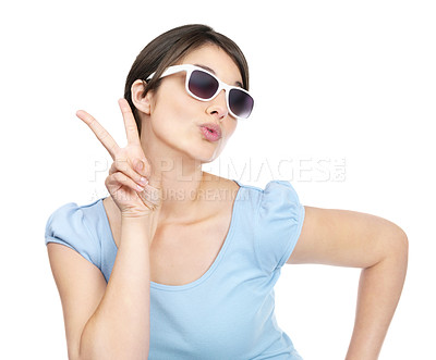 Buy stock photo Cute young female posing with a peace sign and sunglasses against white