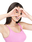 Pretty young lady making heart shape sign