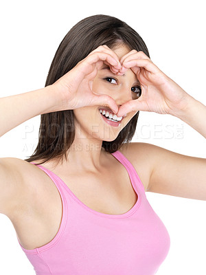Buy stock photo Portrait of a pretty young lady making heart shape sign against white background