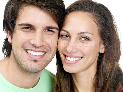 Buy stock photo Closeup portrait of smiling young couple in love on white background