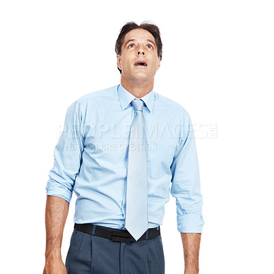 Buy stock photo Shot of a businessman looking up at copyspace against a white background