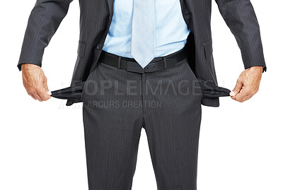 Buy stock photo Cropped studio shot of a businessman pulling out his empty pockets revealing he has no money