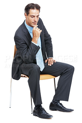 Buy stock photo Shot of a mature businessman sitting on a chair and looking thoughtful isolated on white