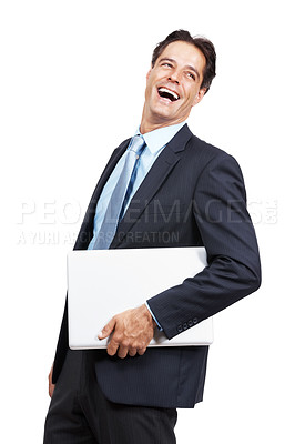 Buy stock photo Studio shot of a businessman laughing while holding a laptop against a white background