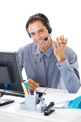 Buy stock photo Portrait of a happy businessman with headset working at his office desk