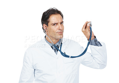 Buy stock photo Portrait of male doctor examines something with stethoscope on white background