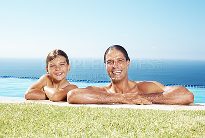 Buy stock photo Portrait of happy father and son in water pool on a summer day - Copyspace