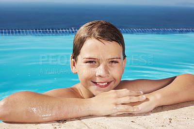Buy stock photo Cute little kid leaning on the side of a swimming pool - Enjoying vacations