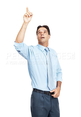 Buy stock photo Shot of a businessman pointing up at copyspace against a white background