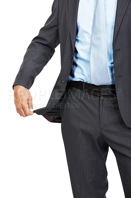 Buy stock photo Cropped studio shot of a businessman pulling out his empty pocket revealing he has no money