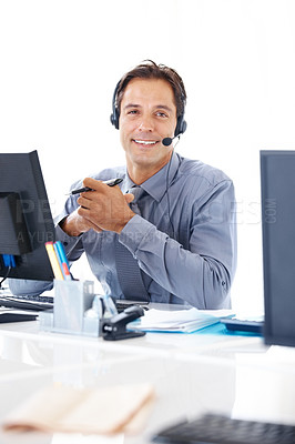 Buy stock photo Portrait of confident business executive with headset working at his office desk
