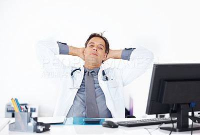 Buy stock photo Portrait of medical doctor sitting relaxed in his office during break time