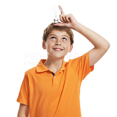 Buy stock photo Portrait of small child holding a light bulb over his head isolated against white background
