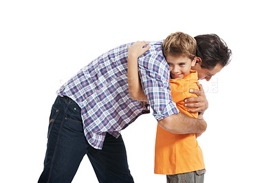 Buy stock photo Portrait of father and son hugging each other isolated on white background