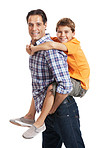 Man giving  son a piggyback ride against white