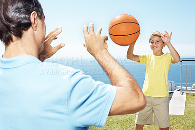 Buy stock photo Little boy boy passing a basket ball to his father - Playing outdoors