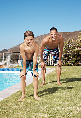 Buy stock photo Portrait of a happy little boy and his father standing near swimming pool with hands on knees - Outdoor