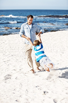 Buy stock photo Full length of a happy man swinging his son at the beach - Enjoying vacation