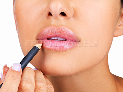Buy stock photo Cropped image of a young lady applying lipliner on her lips against white  background