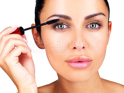 Buy stock photo Closeup portrait of a gorgeous young female applying mascara to her eyes