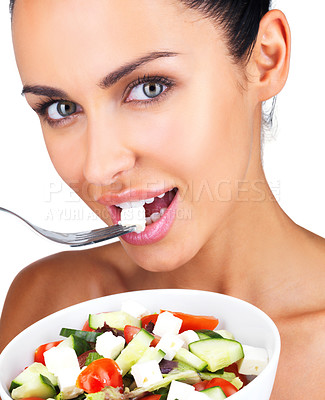 Buy stock photo Closeup portrait of a gorgeous young girl eating vegetable salad against white background