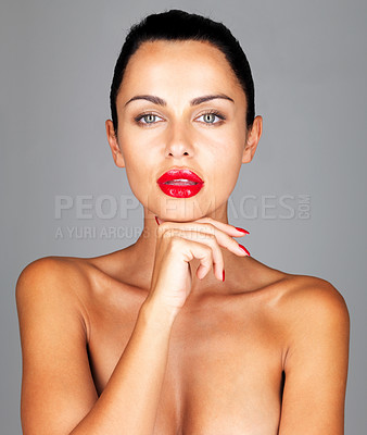 Buy stock photo Closeup portrait of a topless young woman posing against grey background