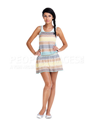 Buy stock photo Full length of a pretty young woman posing confidently against bright background