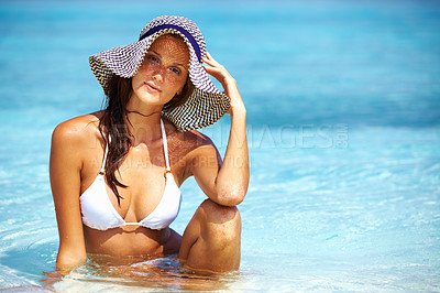 Attractive woman relaxing in sun hat
