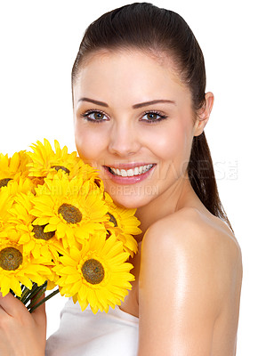 Buy stock photo Beautiful portrait of a young woman holding a bunch of bright yellow daisies, isolated on white - copyspace