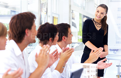 Buy stock photo Cropped shot of a group of coworkers applauding while in a meeting