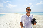 Yuri Arcurs on a deserted Island in the Maldives doing a photo shoot