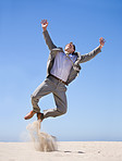 Businessman jumping in air, great success