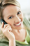 Closeup of a smiling casual female speaking over the cellphone
