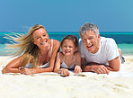 Happy family lying on the beach having fun