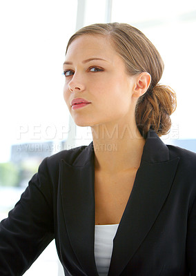 Buy stock photo Portrait of a young businesswoman sitting in her office
