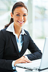 Businesswoman smiling and portraying towards camera
