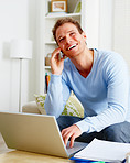 Modern man laughing joyfully talking on mobile phone