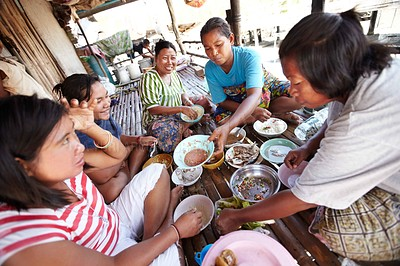 Buy stock photo A group of native women sitting in a circle and sharing a meal