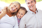 Portrait of happy young family smiling together