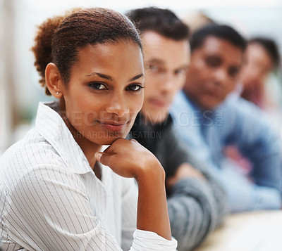Buy stock photo Portrait of a pretty African American business woman in a conference with colleagues