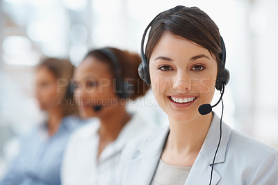 Buy stock photo Closeup of a cute business woman with headset at workplace