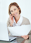 Portrait of pretty lady talking on cell phone while working