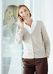 Happy mature woman talking on mobile phone