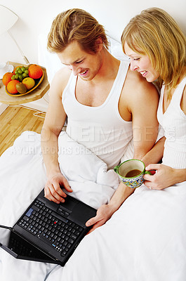 Buy stock photo Young couple browsing the internet from their bed. This is Asks real girlfriend.