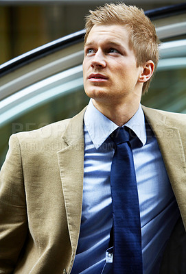 Buy stock photo Confident businessman - A trendy European businessman with a blue tie and shirt.