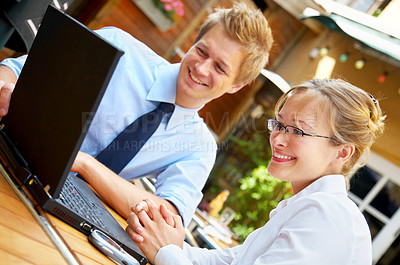 Buy stock photo Two businesspeople working together