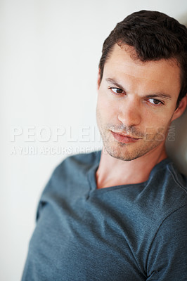 Buy stock photo Portrait of confident young man leaning against the wall