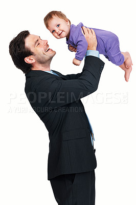 Buy stock photo Side view of cheerful business man playing his baby boy