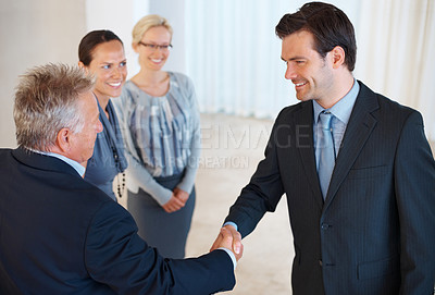 Buy stock photo Portrait of two business people giving handshake to each other